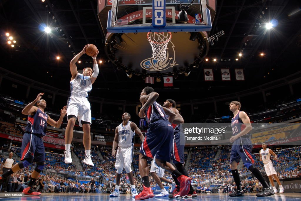 Gustavo Ayon #19 of the Orlando Magic grabs an offensive rebound against the Atlanta Hawks during the game on December 12, 2012 at Amway Center in Orlando, Florida.