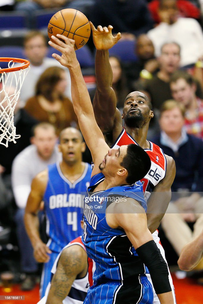 Gustavo Ayon of the Orlando Magic has his shot blocked by Emeka Okafor of the Washington Wizards during the second quarter at Verizon Center on...