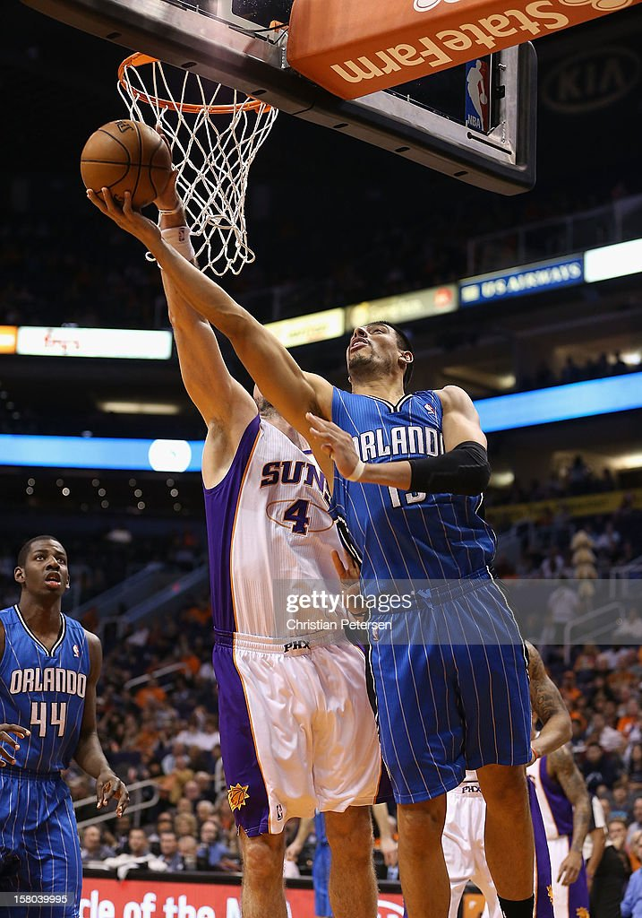Gustavo Ayon #19 of the Orlando Magic lays up a shot against the Phoenix Suns during the NBA game at US Airways Center on December 9, 2012 in Phoenix, Arizona.