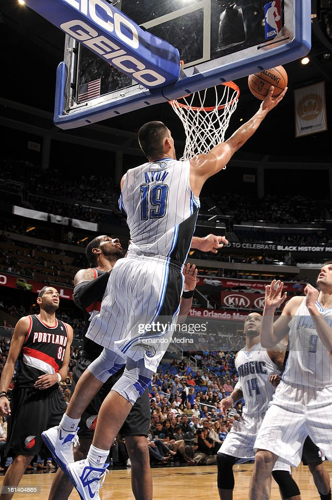 Gustavo Ayon #19 of the Orlando Magic shoots a reverse layup against the Portland Trail Blazers on February 10, 2013 at Amway Center in Orlando, Florida.