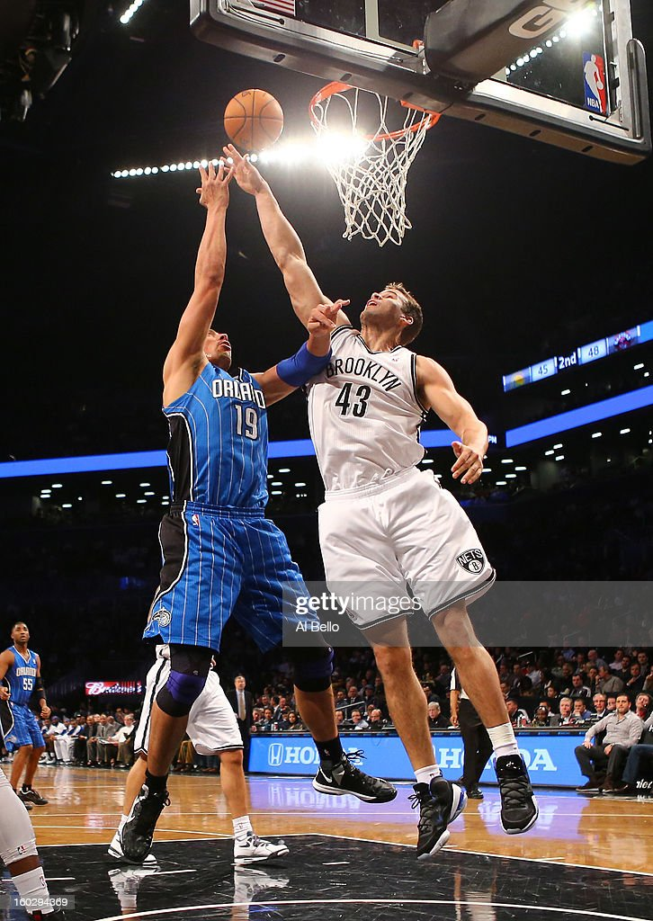 Gustavo Ayon #19 of the Orlando Magic shoots against Kris Humphries #43 of the Brooklyn Nets during their game at the Barclays Center on January 28, 2013 in the Brooklyn borough of New York City.