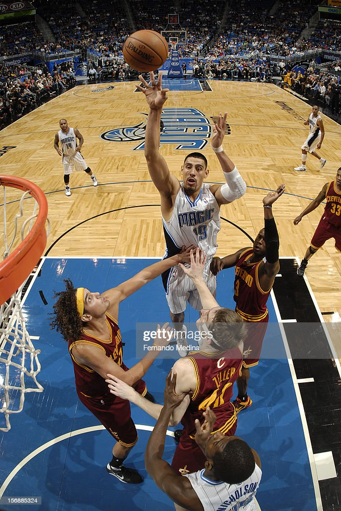 Gustavo Ayon #19 of the Orlando Magic shoots against the Cleveland Cavaliers on November 23, 2012 at Amway Center in Orlando, Florida.