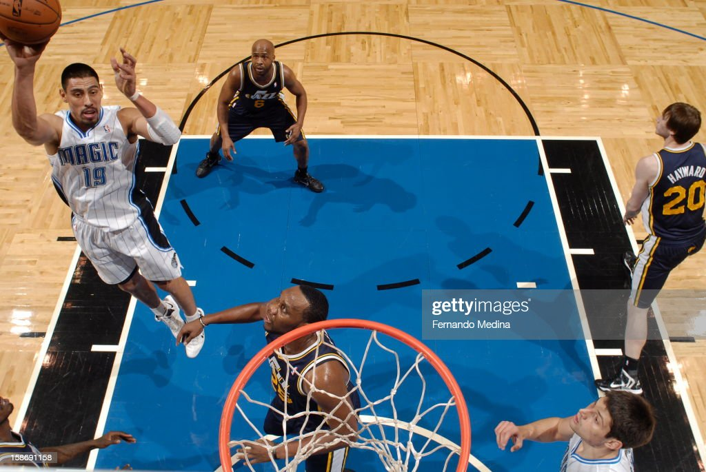 <a gi-track='captionPersonalityLinkClicked' href=/galleries/search?phrase=Gustavo+Ayon&family=editorial&specificpeople=4474343 ng-click='$event.stopPropagation()'>Gustavo Ayon</a> #19 of the Orlando Magic throws up a floater against the Utah Jazz during the game on December 23, 2012 at Amway Center in Orlando, Florida.