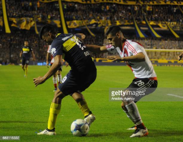 Gustavo Bou of Boca Juniors fights for the ball with Diego Martinez Quarta of River Plate during the match for the twentyfourth date of the...