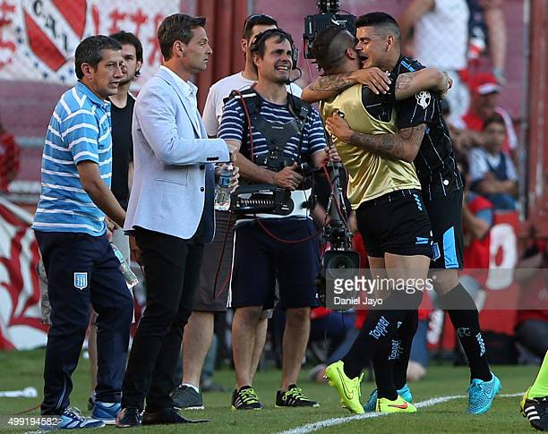 Gustavo Bou of Racing Club celebrates with teammates after scoring the opening goal during a first leg match between Independiente and Racing Club as...
