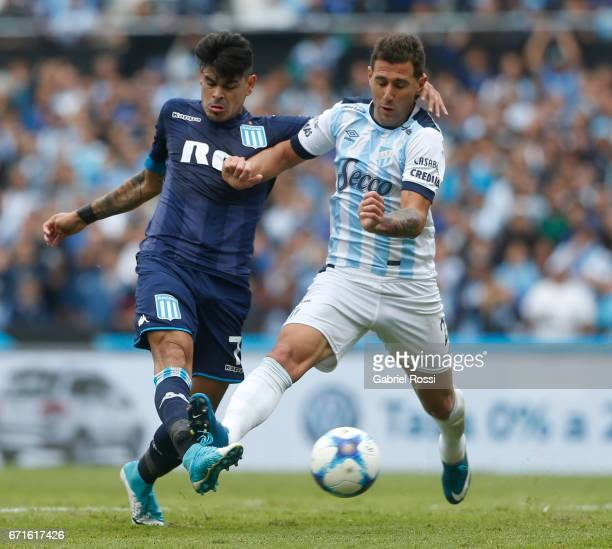 Gustavo Bou of Racing Club fights for the ball with Bruno Bianchi of Atletico de Tucuman during a match between Racing and Atletico de Tucuman as...