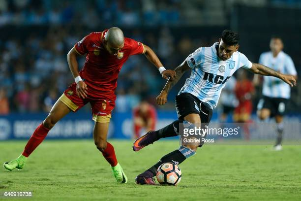 Gustavo Bou of Racing Club fights for the ball with Daniel Muñoz of Rionegro Aguilas during a first leg match between Racing and Rionegro Aguilas as...
