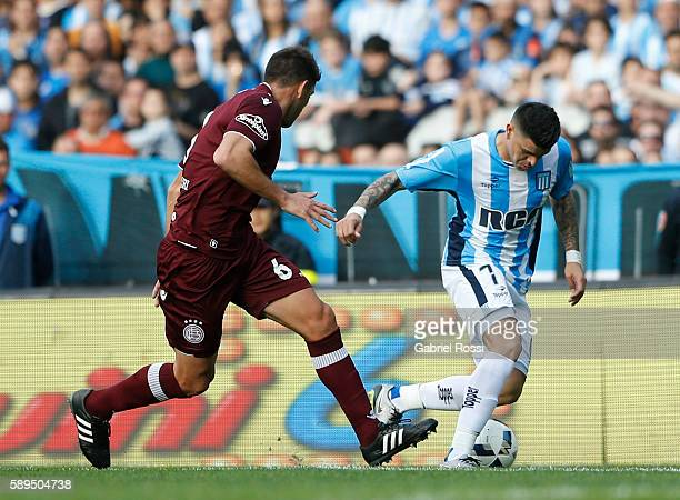 Gustavo Bou of Racing Club fights for the ball with Diego Braghieri of Lanus during a match between Racing Club and Lanus as part of Copa del...