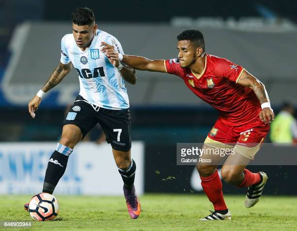 Gustavo Bou of Racing Club fights for the ball with Edwin Peraza of Rionegro Aguilas during a first leg match between Racing and Rionegro Aguilas as...