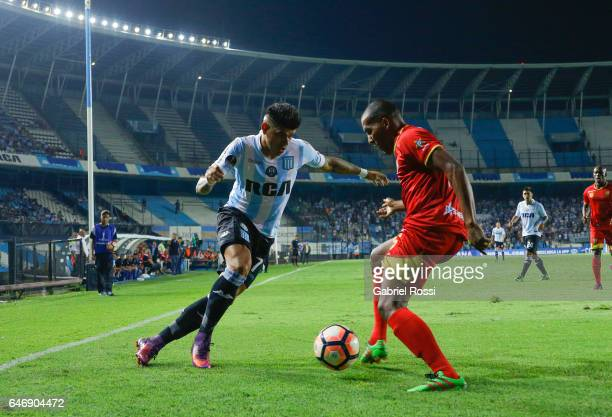Gustavo Bou of Racing Club fights for the ball with Fabio Dario Rodriguez of Rionegro Aguilas during a first leg match between Racing and Rionegro...