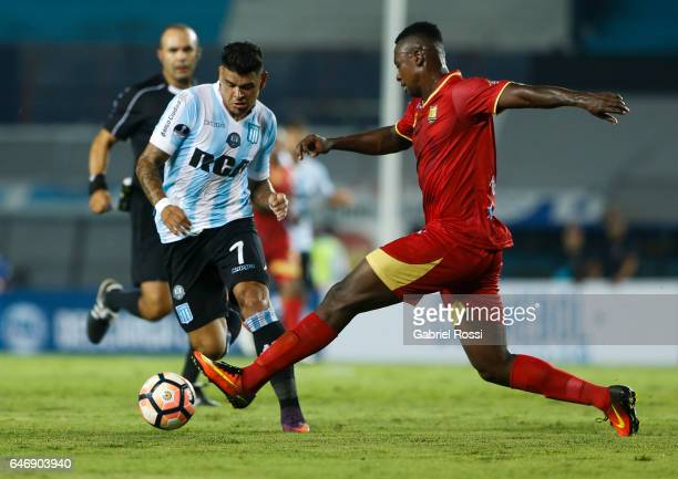 Gustavo Bou of Racing Club fights for the ball with Hanyer Mosquera of Rionegro Aguilas during a first leg match between Racing and Rionegro Aguilas...