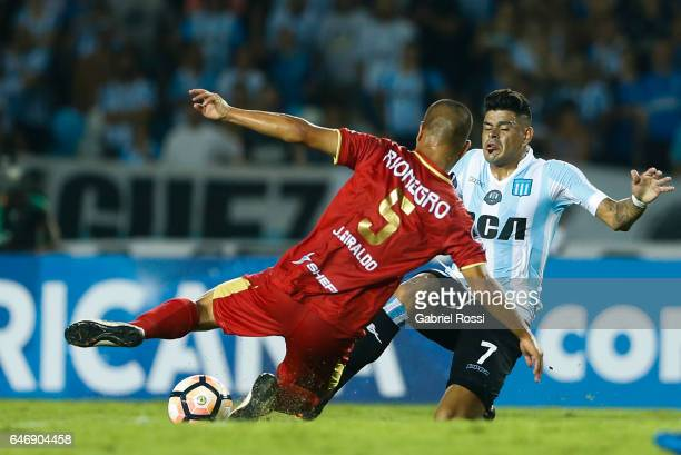 Gustavo Bou of Racing Club fights for the ball with Juan Diego Giraldo of Rionegro Aguilas during a first leg match between Racing and Rionegro...