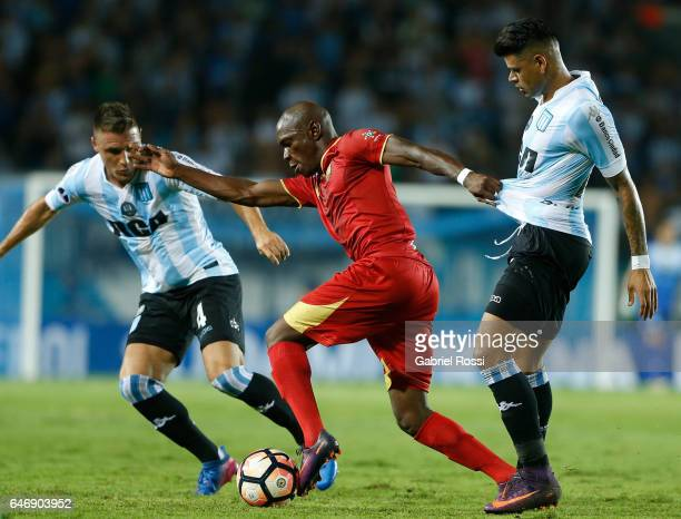 Gustavo Bou of Racing Club fights for the ball with Luis Orlando Hurtado of Rionegro Aguilas during a first leg match between Racing and Rionegro...