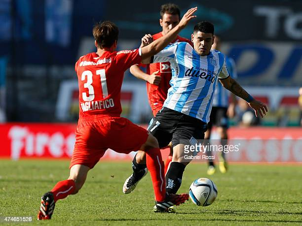 Gustavo Bou of Racing Club fights for the ball with Nicolas Tagliafico of Independiente during a match between Racing Club and Independiente as part...