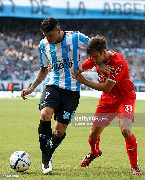Gustavo Bou of Racing Club vies for the ball with Nicolas Tagliafico of Independiente during a match between Racing Club and Independiente as part of...