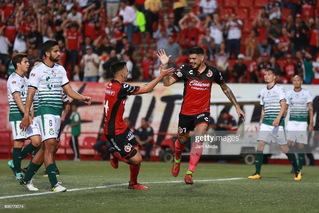 Gustavo Bou (R) of Tijuana celebrates with Luis Chavez (L) after scoring the opening goal for his team during the fifth round match between Tijuana and Santos Laguna as part of the Torneo Apertura 2017 Liga MX at Caliente Stadium on August 18, 2017 in Tijuana, Mexico.