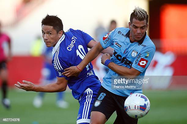 Gustavo Canales of Universidad de Chile fights for the ball with Cristian Baez of Deportes Iquique during a match between Universidad de Chile and...