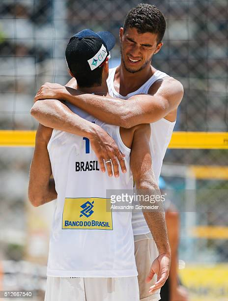 Gustavo Carvalhaes and Saymon Barbosa of Brazil celebrate their victory after winning the quarters final match against Poland at Pajucara beach...