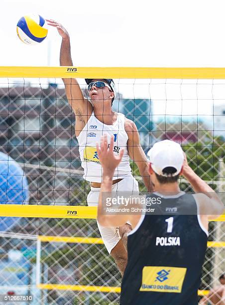 Gustavo Carvalhaes of Brazil spikes the ball against Poland during the quarters final match against Poland at Pajucara beach during day five of the...