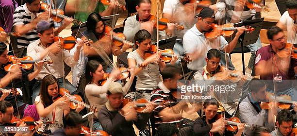 Gustavo Dudamel and his youth orchestra perform at the South Bank's Royal Festival Hall on April 15 2009 in London England The group of young...