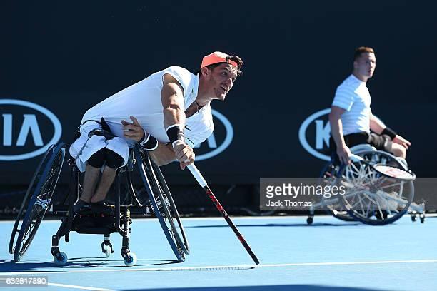Gustavo Fernandez of Argentina and Alfie Hewett of Great Britain compete in their Men's Wheelchair Doubles Final against Joachim Gerard of Belgium...