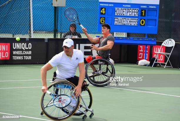 Gustavo Fernandez of Argentina and Maikel Scheffers of Holland in action against Stephane Houdet and Nicolas Peifer of France of Holland in the final...