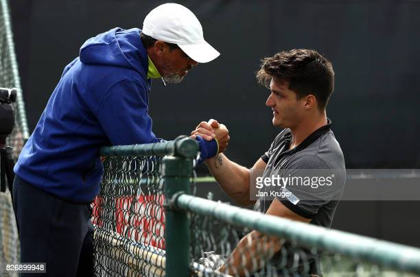 Gustavo Fernandez of Argentina celebrates with his coach after the British Open Wheelchair Tennis mens singles final match against Alfie Hewett of...