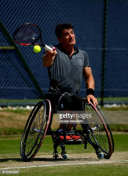 Gustavo Fernandez of Argentina plays a forehand during his third round match against Shingo Kunieda of Japan during day two of the Surbiton...