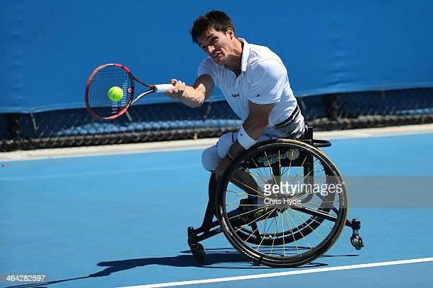 Gustavo Fernandez of Argentina plays a forehand in his quarterfinal wheelchair singles match against Michael Jeremiasz of France during day 10 of the...