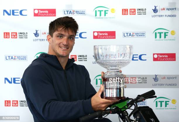 Gustavo Fernandez of Argentina poses with the winners trophy after the British Open Wheelchair Tennis mens singles final match against Alfie Hewett...