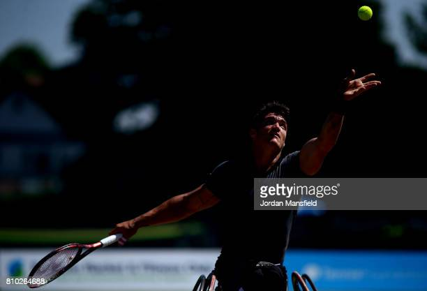 Gustavo Fernandez of Argentina serves during his third round match against Shingo Kunieda of Japan during day two of the Surbiton Wheelchair Tennis...