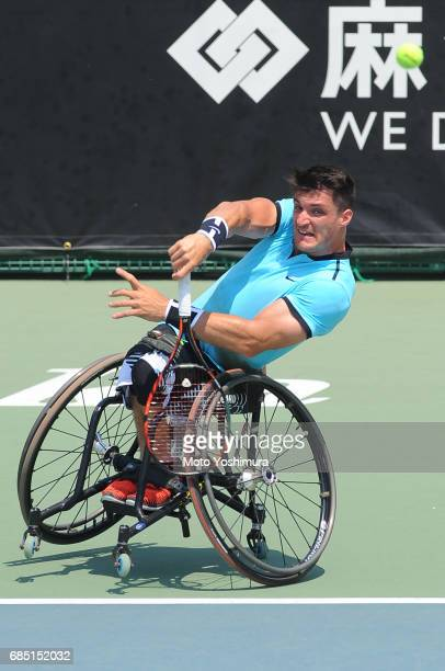 Gustavo Fernandez of Argentina serves during the Men's singles quarter final against Takashi Sanada of Japan during day four of the Wheelchair Tennis...