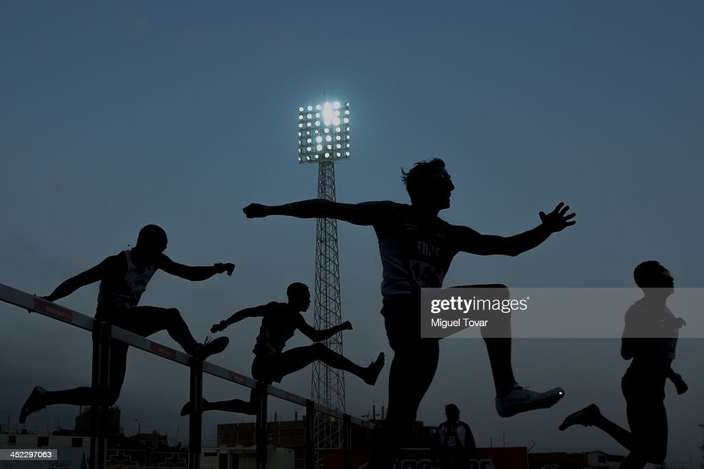 Gustavo Gutierrez of Chile competes in men's 400m hurdles semifinal event as part of the XVII Bolivarian Games Trujillo 2013 at Chan Chan Stadium on November 27, 2013 in Trujillo, Peru.