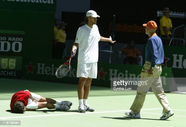 Gustavo Kuerten expresses concern to Chair Umpire Norm Chryst when John Van Lottum goes down with leg cramps at 44 in the 5th set during their first...