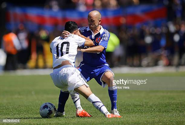 Gustavo Lorenzetti of U de Chile and Martin Rodriguez of Huachipato compete for the ball during a match between Huachipato and U de Chile as part of...