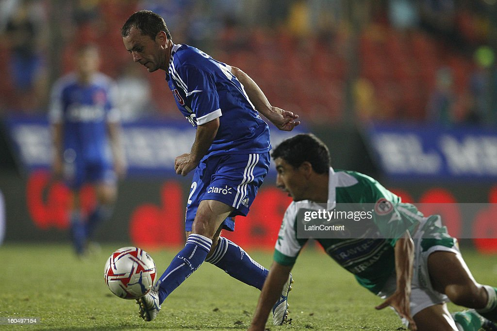 Gustavo Lorenzetti of Universidad de Chile fights for the ball with Ivan Vazquez of Audax Italiano during a match between Universidad de Chile and Audax Italiano as part of the Torneo Transición 2013 at Santa Laura Stadium on February 01, 2013 in Santiago, Chile.