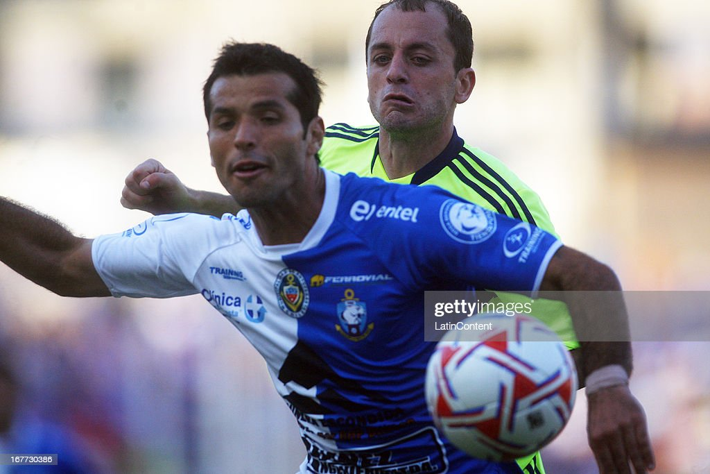Gustavo Lorenzetti of Universidad de Chile, struggles for the ball with Cristian Rojas of Antofagasta during a match between Antofagasta and Universidad de Chile as part of Torneo Descentralizado 2013 at Bicentenario Calvo y Bascunan stadium on April 28, 2013 in Antofagasta, Chile.