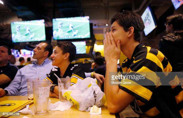 Gustavo Macias right covers his face as he watches the Pittsburgh Steelers play the Tennessee Titans with his brother Leonardo center and father...
