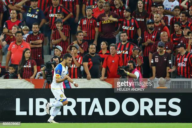 Gustavo Noguera of Paraguay's Deportivo Capiata celebrates upon scoring against Brazil's Atletico Paranaense during their Libertadores Cup football...