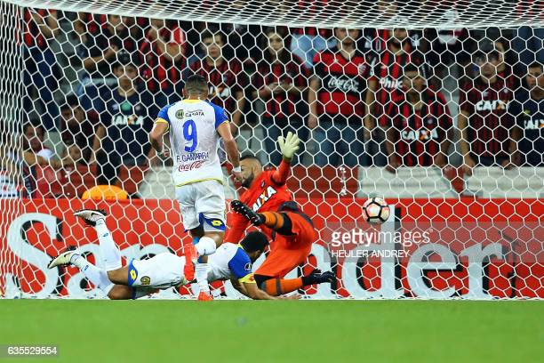 Gustavo Noguera of Paraguay's Deportivo Capiata scores against Brazil's Atletico Paranaense during their Libertadores Cup football match at the Arena...