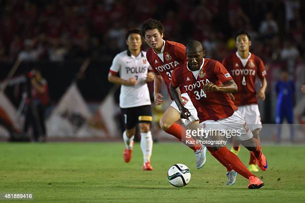Gustavo of Nagoya Grampus dribbles the ball during the JLeague match between Nagoya Granpus and Urawa Reds at Paloma Mizuho Stadium on July 25 2015...