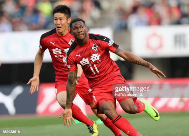 Gustavo of Roasso Kumamoto celebrates scoring the opening goal wiith his team mate An Byong Jun during the JLeague J2 match between Roasso Kumamoto...