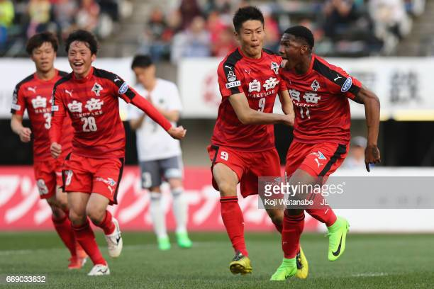 Gustavo of Roasso Kumamoto celebrates scoring the opening goal wiith his team mates during the JLeague J2 match between Roasso Kumamoto and Matsumoto...