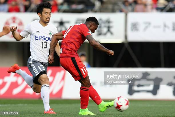 Gustavo of Roasso Kumamoto scores the opening goal during the JLeague J2 match between Roasso Kumamoto and Matsumoto Yamaga at Egao Kenko Stadium on...