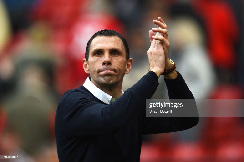 <a gi-track='captionPersonalityLinkClicked' href=/galleries/search?phrase=Gustavo+Poyet&family=editorial&specificpeople=227352 ng-click='$event.stopPropagation()'>Gustavo Poyet</a> the Sunderland manager celebrates his team's 1-0 victory during the Barclays Premier League match between Manchester United and Sunderland at Old Trafford on May 3, 2014 in Manchester, England.