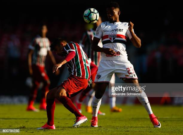 Gustavo Scarpa of Fluminense and Thiago Maia of Sao Paulo in action during the match between Sao Paulo and Fluminense for the Brasileirao Series A...