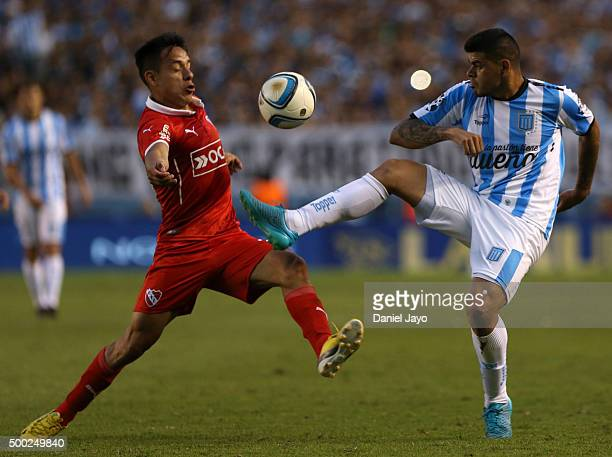 Gustavo Toledo of Independiente and Gustavo Bou of Racing Club fight for the ball during a second leg match between Independiente and Racing Club as...