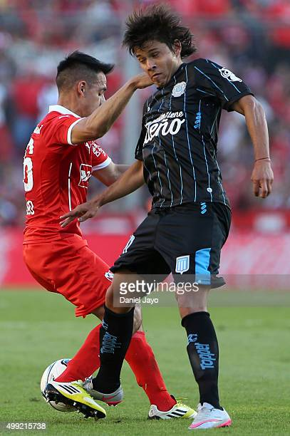Gustavo Toledo of Independiente and Oscar Romero of Racing Club battle for the ball during a first leg match between Independiente and Racing Club as...