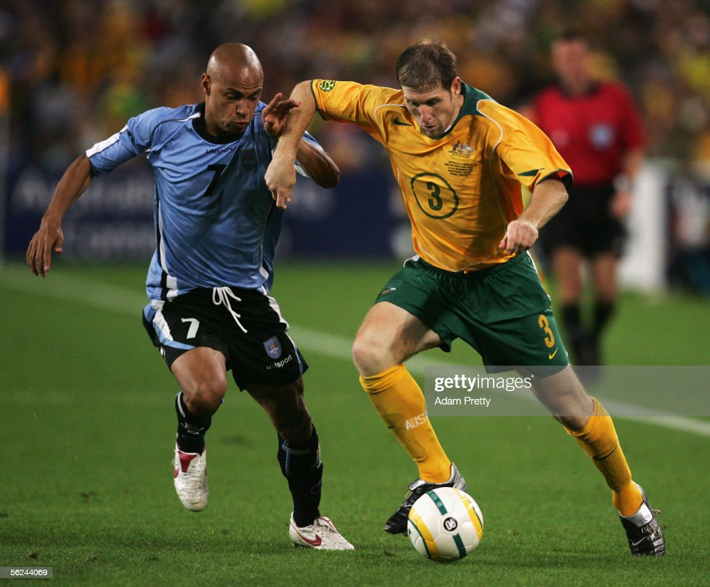 Gustavo Varela of Uruguay and Scott Chipperfield of the Socceroos in action during the second leg of the 2006 FIFA World Cup qualifying match between Australia and Uruguay at Telstra Stadium November 16, 2005 in Sydney, Australia.