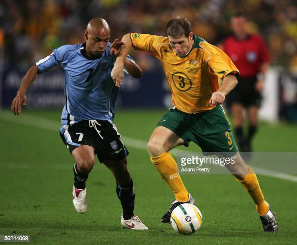 Gustavo Varela of Uruguay and Scott Chipperfield of the Socceroos in action during the second leg of the 2006 FIFA World Cup qualifying match between...